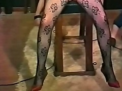 Vintage movie of mistress who ties slave to a table and play
