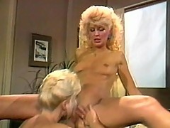 Two mature blonde lezbos stare at each other