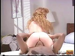 Vintage Interracial Action With A Sexy Redheaded Vixen Getting Banged