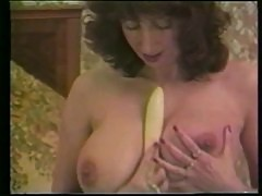 Retro busty girl plays with her dildo