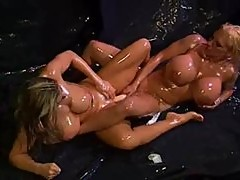 Lesbians covered in oil lick and toy