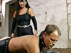 Busty Tiziana Redford fucks her devote slave with a strapon dildo